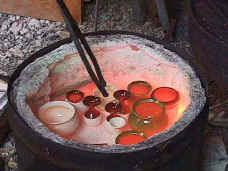 Removing pots from Raku kiln.